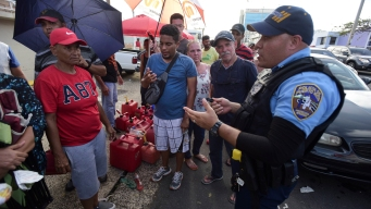 Thousands of Puerto Rico Police Owed Overtime Call in Sick