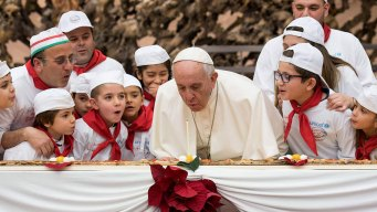 Pope Francis Blows out Birthday Candle on Extra-Long Pizza