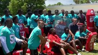 Dolphins Donate Equipment After High School Fire