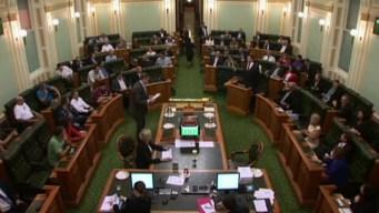 Shoeless, Shirtless, Breathless, Aussie Lawmakers Still Vote