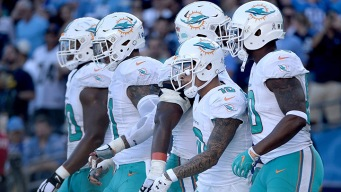 Late Interceptions Help Dolphins Beat Chargers