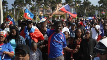 Local Haitians Protest President Trump in West Palm Beach