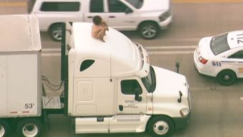 Naked Woman on Big Rig Cab Stops Highway Traffic