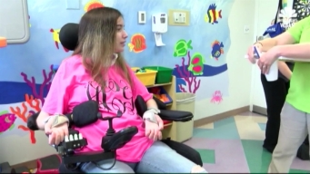Paralyzed Teen Paints With a Purpose