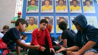 Analog Charm of World Cup Sticker Book Endures Among Fans
