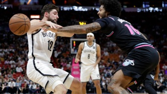 Nets Add to Miami's Home Misery, Top Heat 104-92