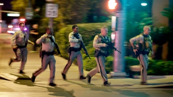 Footage Shows Vegas Police Helping People Dodge Gunfire