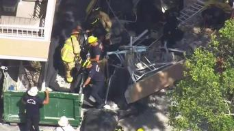 Officials Rescue Worker Trapped in Dumpster