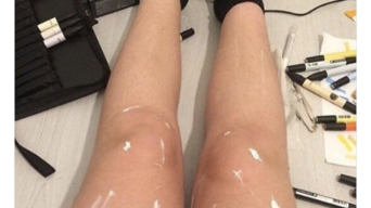 Oil or Paint: Shiny Legs Photo Sweeping the Internet