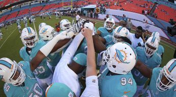 Dolphins Hold On to Spoil Chargers' LA Debut
