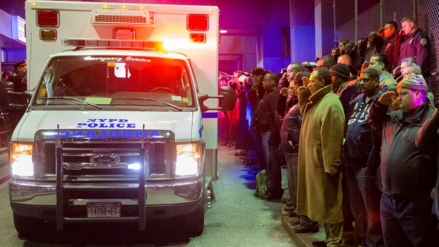 Dramatic Photos: 2 NYPD Officers Killed in Ambush