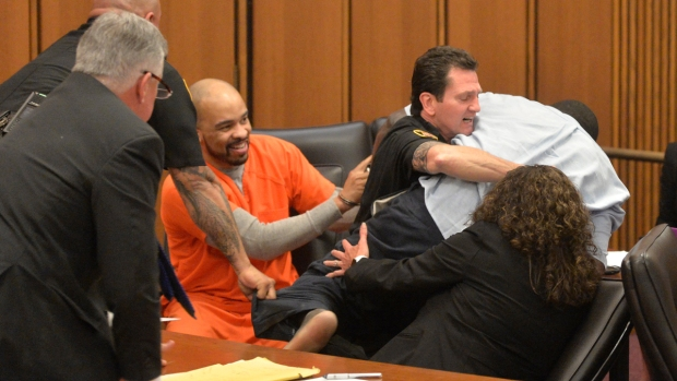 Man Jumps Over Table to Attack His Daughter's Killer in Court
