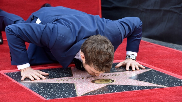 [NATL] Top Entertainment Photos: Michael Bublé's Walk of Fame Star, the Latin Grammys, and More
