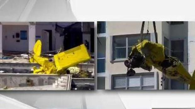 [MI] Investigators Remove Plane Wreckage From Condo