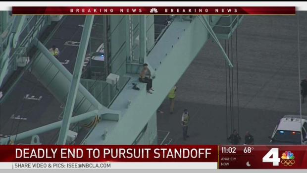 Suspect climbs crane during Los Angeles pursuit