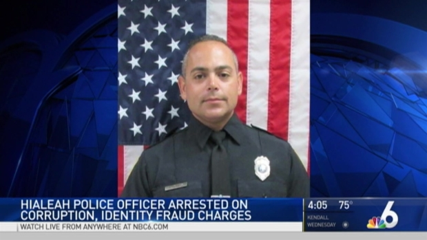 Image result for Hialeah police officer arrested on corruption, identity fraud charges
