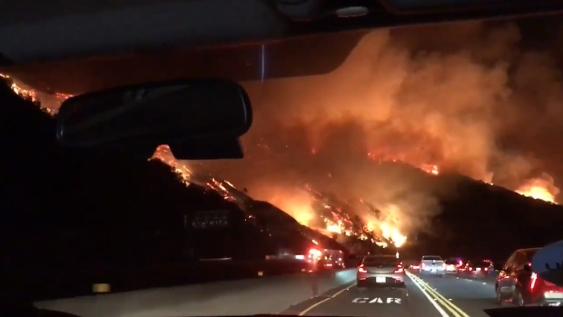 LA Drivers Pass Raging Wildfire During AM Commute