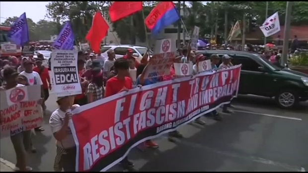 [NATL] Protesters March Against Trump in Philippines, UK