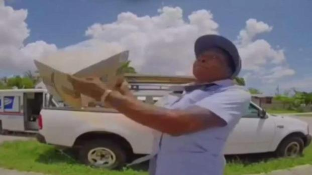 [MI] Postal Workers Caught on Camera Throwing Packages