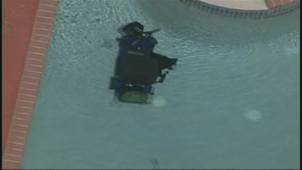 [MI] RAW VIDEO: Motorized Wheelchair in Pool at Scene of Apparent Drowning