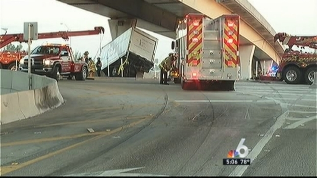 [MI] Dangling Box Truck Pulled Onto South Florida Highway Overpass