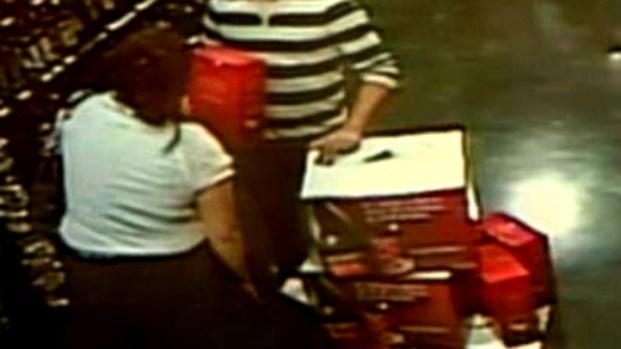 [MI] Woman Stuffs Liquor Bottles in Skirt in Video from Miramar Store