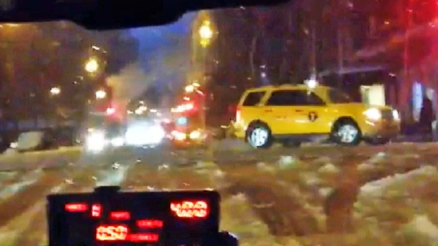 [NY] WATCH: Taxi Drives in Midtown During Ice Storm