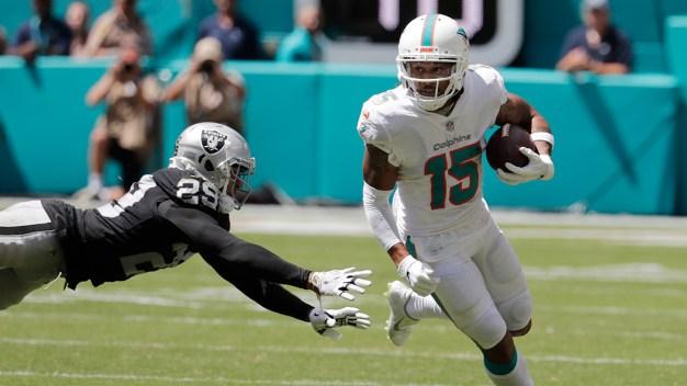 Trick Plays Help Unbeaten Dolphins Beat Raiders 28-20