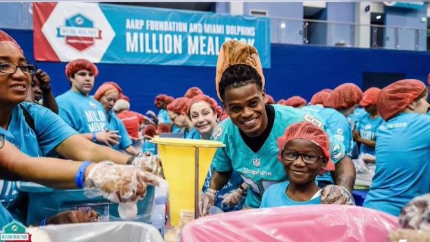Dolphins, AARP Team Up to Help Feed South Florida