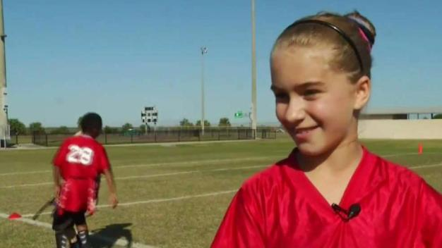 Female Football Players Kicking Down Barriers