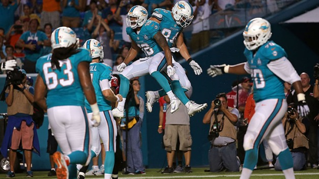 Dolphins Take Down Falcons in Close Battle