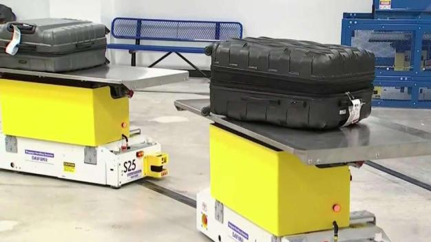 MIA Unveils New Automatic Baggage Screening System
