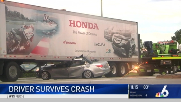 Driver Escapes Serious Injury After Car Goes Under Semi-Truck