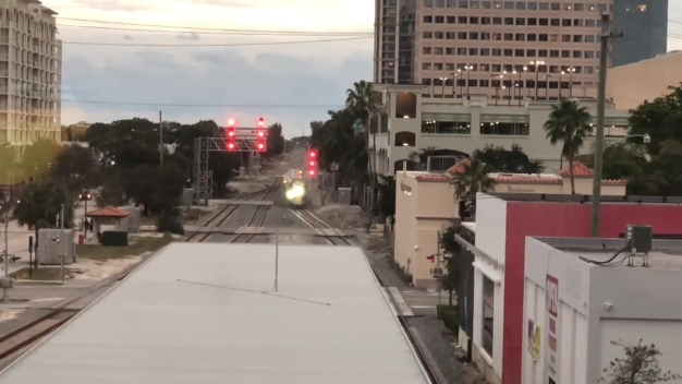 RAW VIDEO: Passenger Crosses Train Tracks While Brightline Train Approaches