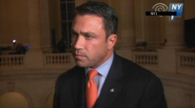 [AP] NY Rep. Threatens to Throw Reporter Off Balcony