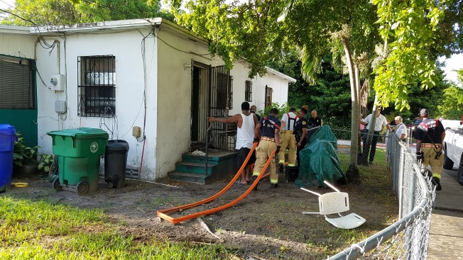 Man, Dog Rescued From Liberty City House Fire Being Investigated as Possibly Set On Purpose