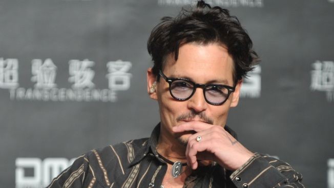 "Johnny Depp Confirms Engagement, Shows Off ""Chick's Ring"""