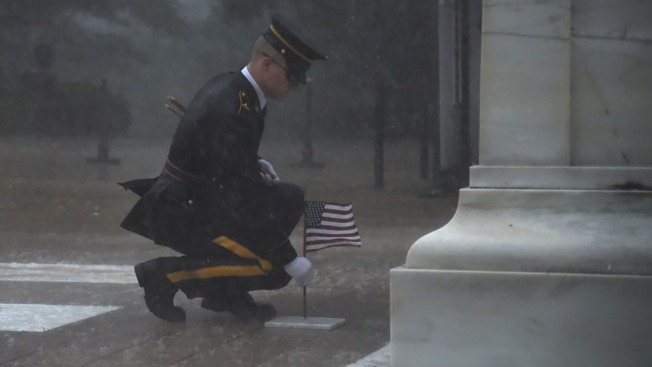 Photo Captures Tomb of the Unknown Soldier Guards Placing Flags Through Severe Rainstorm