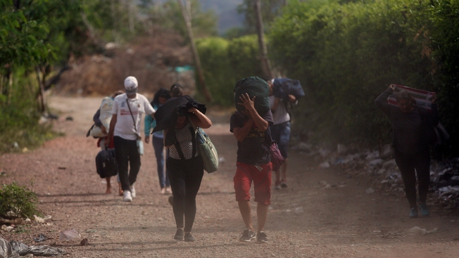 Follow the Trek of Venezuelan Migrants Fleeing on Foot