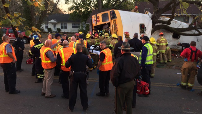 Image result for 6 students in ICU after school bus driver charged in crash that killed Woodmore Elementary students