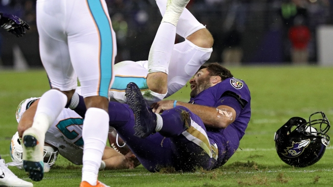 Angry Ravens Say QB Flacco's Concussion Was on 'Dirty Play' by Dolphins' Kiko Alonso