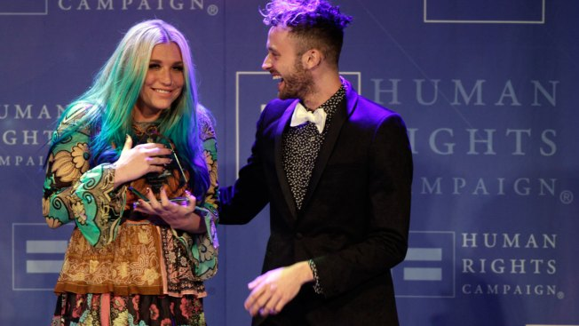 Kesha Chokes up at Award Dinner, Thanks Supporters