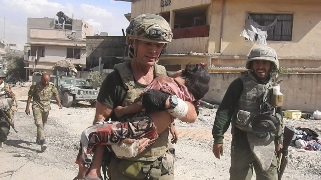 Video Shows Aid Worker Brave ISIS Gunfire to Rescue Little Girl in Mosul