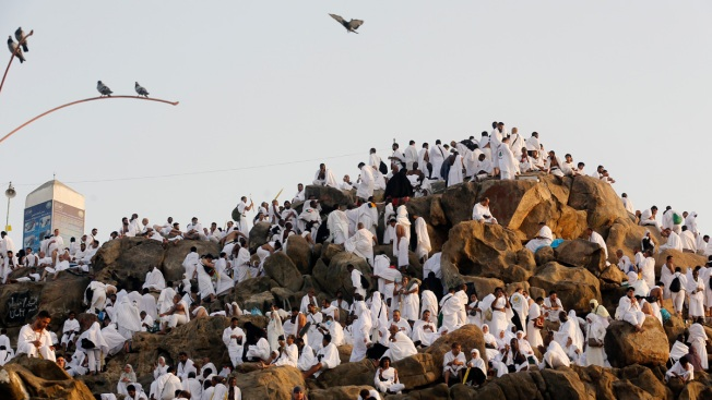 Muslim Hajj Pilgrims Ascend Mount Arafat for Day of Worship