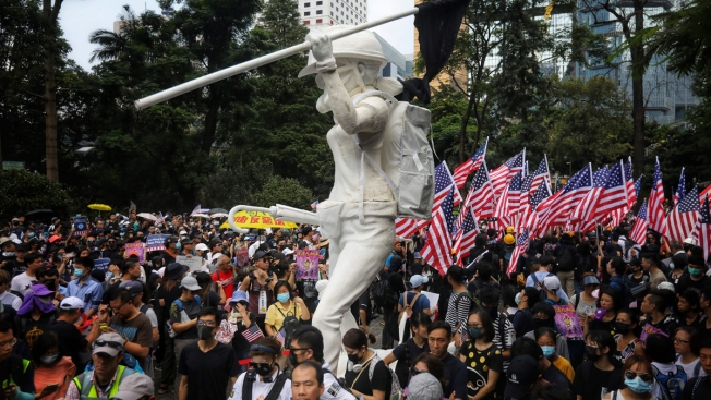 Marchers Ask Trump to 'Liberate' Hong Kong, as Clashes Erupt