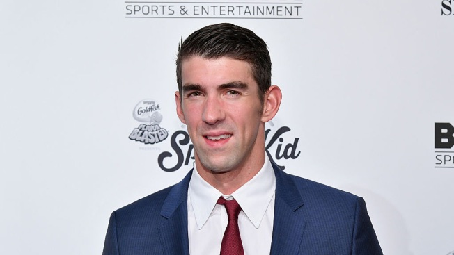 Michael Phelps participating in Shark Week this summer