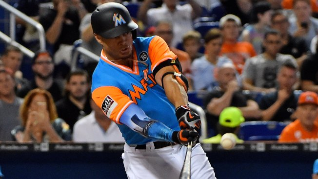 Rojas' sacrifice fly helps Marlins beat Padres 2-1 in 11