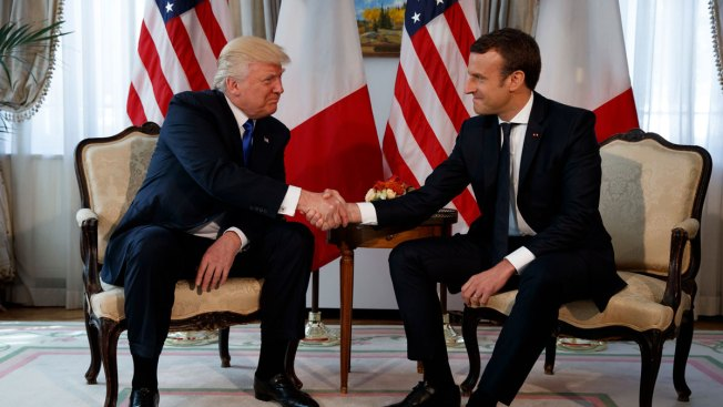 Donald Trump and Emmanuel Macron exchanged a white-knuckled handshake