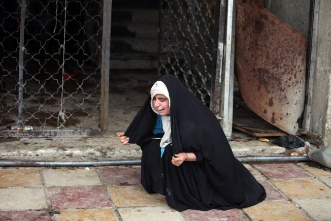 Two Blasts Kill at Least 75 in Iraq