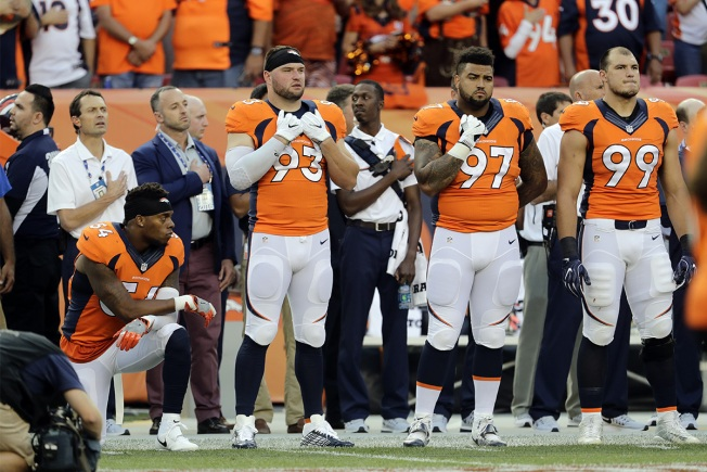 Brandon Marshall stands behind his National Anthem protest